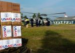 The crew of USS Abraham Lincoln (CVN 72) loads boxes of food and water donated by USAID during humanitarian aid missions to Aceh, Sumatra, Indonesia. U.S. Navy photo by Photographer's Mate 3rd Class Tyler J. Clements