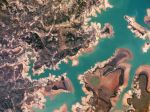 Três Marias Reservoir, Minas Gerais Brazil - Planet Labs Satellite image. The Represa Três Marias, the result of damming the São Francisco river, is one of the largest reservoirs in Brazil. In 2014, Minas Gerais experienced one of the worst droughts of the last 50 years.