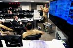 Naval District Washington (NDW) officials present their smart grid pilot to John Conger  (U.S. Navy photo by Mass Communication Specialist 2nd Class Kiona Miller/Released)